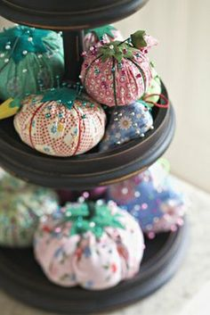 Re-purpose those old garment or material scraps into pin cushions.