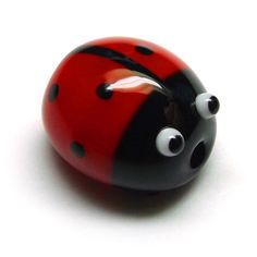 Lampwork glass ladybird (ladybug) bead by Laura Sparling. Available as single beads, bracelet charms and knitting or crochet stitch markers.