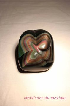 Rainbow Obsidian | #Geology #GeologyPage #Mineral  Locality: Mexico Size: 6.9 x 7.4 cm Weight:151 g  Photo Copyright © Catherine Gilbert  Geology Page www.geologypage.com