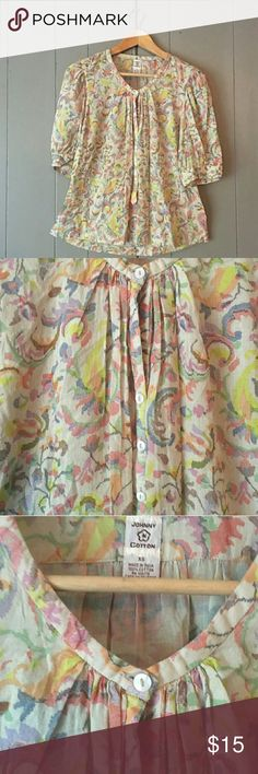 """JOHNNY COTTON Floral 3/4 Sleeve Top XS/S Re-posh, just wasn't as long on me as I had anticipated.  Otherwise fit perfectly and is super cute!  In perfect like new condition.  High low made of 100% cotton and flowy fit.   Measuments take while item was laying flat : 17"""" pit to pit. Length is 23"""" in the front and 24"""" in the back.  (Runs big, fits more like a small)  🔶PRICES ARE FIRM, UNLESS BUNDLED 2 OR MORE ITEMS. Johnny Cotton Tops Blouses"""