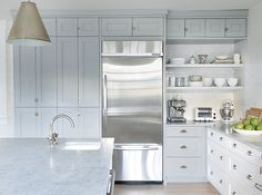 Pantry Walls We called ready-made freestanding pantries as a big 2018 t … Pantry Walls We called out ready-made freestanding pantries as a big 2018 trend in our January issue, but the pantry wall is another fresh take. In this kitchen, the pantry Kitchen Pantry Cabinets, Kitchen Tops, New Kitchen, Kitchen Decor, Cupboards, Wall Pantry, Open Pantry, Kitchen Paint, Kitchen Ideas