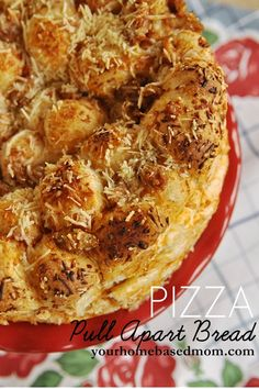 "Pizza-Pull- Apart-Bread: 16 frozen white dinner rolls,  1/2 C pizza sauce,  1 C grated Parmesan cheese divided,  1/2 C sausage crumbles.      Thaw frozen rolls for 45"".  Cut rolls in half.   Pour pizza sauce & 1/2 C cheese over dough & stir to coat. Add sausage or meat of choice.  Coat each piece.  Place dough in a 9"" pan & top with cheese.  Let rise. Bake@ 350 for 20-25""."