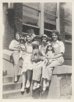 Vintage photo of pre-teen girls with their dolls, circa 1940's.