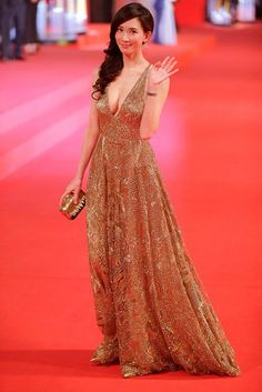 Taiwanese model and actress Lin Chi-ling waves on the red carpet for the opening ceremony of the 17th Shanghai International Film Festival in Shanghai, China, June 14, 2014