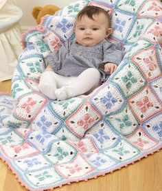 This baby afghan can be stitched with either Red Heart® Classic™ or Red Heart® Super Saver® yarn. Easy crochet instructions make a 38 x x blanket. Baby Afghans, Baby Afghan Crochet, Afghan Crochet Patterns, Crochet Squares, Baby Patterns, Baby Blankets, Knitting Patterns, Crochet Blankets, Granny Squares