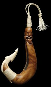 Maori Fish hook carved in wood and mammoth ivory with a paua shell inlay by Len Kay.   www.boneart.co.nz