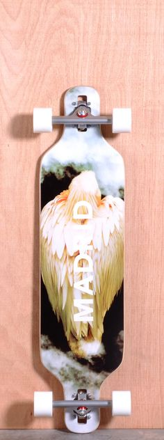 "The Madrid Bird Longboard Complete is designed for Carving and Cruising. Ships fully assembled and ready to skate! Function: Carving, Cruising Features: Drop Through, Rocker, W Concave, Symmetrical Twin Tip Material: 11 Ply Maple Length: 39"" Width: 9.625"" Wheelbase: 29"" Thickness: 9/16"" Hole Pattern: New School Grip: Black"