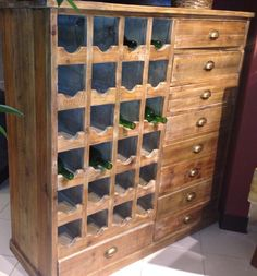 Showcase your wine collection with this distressed wood wine rack.   Houston TX   Gallery Furniture  