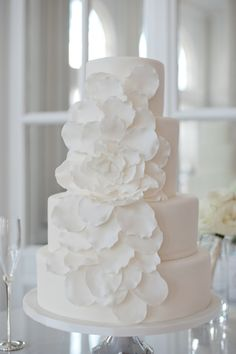 LOVE this cake from Sweet Sensations.  The ruffles matched the brides dress :)