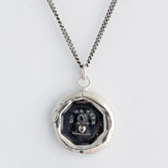 This wax seal necklace reads Tu Me Fixe in French meaning You Complete Me. The butterfly is a symbol of the soul; the heart, love. Shown together they represent soul mates.