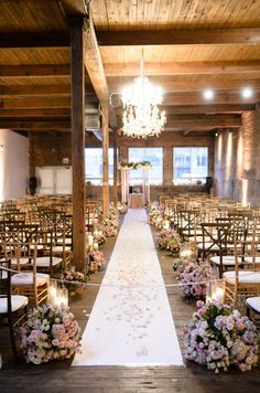 Loose clusters of pink and white blooms adorn a rose petal covered aisle. Wedding Ceremony, Aisle decor