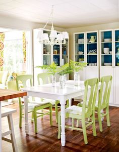 Breezy Dining Room With Green On The Table