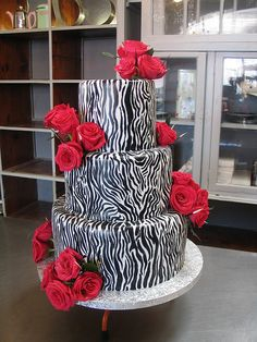 Zebra Stripe chocolate wedding cake with Cerise pink roses by Charly's Bakery, via Flickr