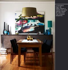 Dark colors and wood do the perfect and cozy dining room .
