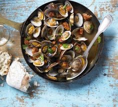 Steam fresh shellfish with sherry to bring out the sweetness then contrast with spicy Spanish sausage.