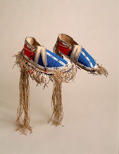 Man's Moccasins Date: ca. 1850 Geography: United States, Upper Missouri region Culture: Probably Lakota (Teton Sioux) Medium: Native-tanned leather, glass beads, wool cloth, metal cones, porcupine quills