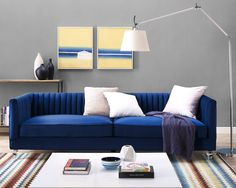 Aviator Velvet Sofa in Navy. $1286 USD. Offering a contemporary flair with a touch of sophistication, this velvet sofa is unique yet comfortable; from the perfect pleats to the Lucite legs and rich color options.