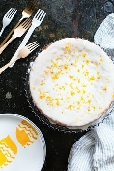 A polenta cake recipe infused with fragrant vanilla and meyer lemon.  The cake is finished with crème fraîche glaze and flecks of fresh meyer lemon zest.