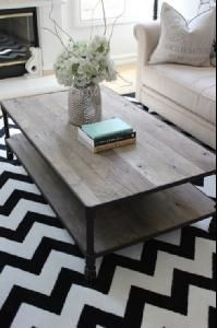 love this industrial coffee table