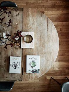 books on a round wood farmhouse table via sfgirlbybay | kinfolk | simple rustic home decor