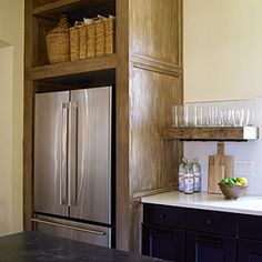 Facing French door refrigerators help balance the room and provide extra storage for large crowds or parties.