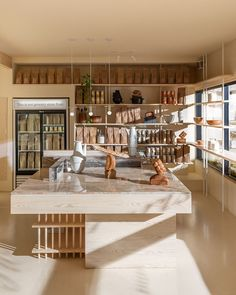 "Ste Marie decorates Vancouver bakery and flour mill in ""malty hues"" – Guillaume Bodonnat - Decoration Vancouver, Communal Table, Flour Mill, Small Sink, Built In Seating, Bakery Cafe, Retail Space, Interior Design Studio, Best Interior"