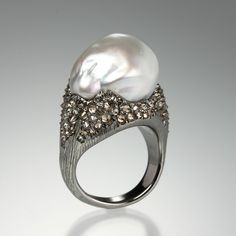 Seriously killer cool ring by Arunsahi...An 18K rhodium plated gold ring with a large baroque south sea pearl and 1.99cttw reverse set diamonds. LOVE!
