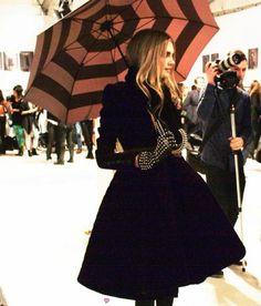 studded gloves, jacket, umbrella