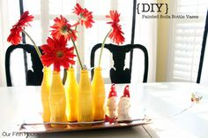 Kitchen, Most Inspiring Everyday Kitchen Table Centerpieces: Creative DIY Painted Soda Bottle Vases Ith Tangerine Flowers For Table Centerpi...