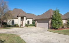 Beautiful 4 bedroom, 2 bath, French Style home situated on a lake lot with excellent curb appeal!