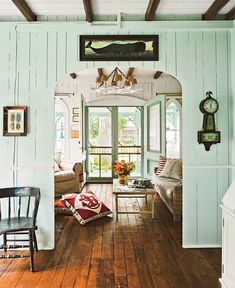 I enjoy the open-air, lighter look of the doors, windows and walls against the dark stain of the hardwood flooring; the floor lends a SOLID look, while the wall colour and double doors make the whole atmosphere seem less imposing