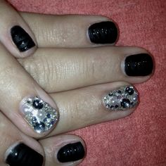 Matte black zebra print with gel and a glitter gel finger with crystals by Erin at The Nail Lounge in Costa Mesa