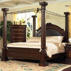 This grand canopy bed is the perfect way to transform your master bedroom into a royal treat. The large arched headboard features tiered edge moulding, a carved motif, and faux leather upholstery for a luxurious sophisticated style. Four fluted columns are topped with ornate post tops that are connected by a scrolled canopy. Finished in a beautiful dark cherry, this impressive poster bed will be your self-indulgence. Available in queen and king sizes.
