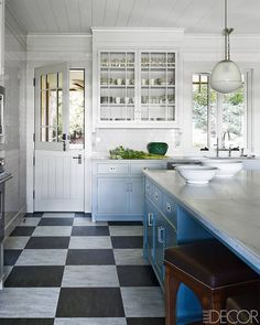 Where do I start? Dutch door, island, nail-studded stool, floor + ceiling, wall cupboard beside the sink, the window over the sink, and o...