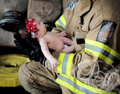 Baby Girl Looking at Firefighter