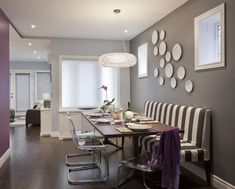 gray dining room with striped banquette bench
