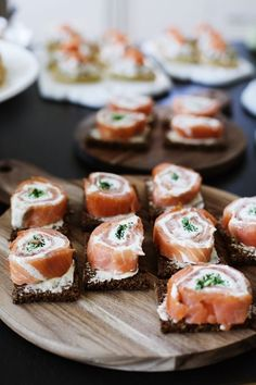 Salmon rolls - YUMMY!! looks like salmon, lil spinach, cream cheese rolled up and put pumpernickel bread.  My mouth is watering!