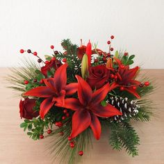 Holiday Glow Centerpiece by Ben White Florist.