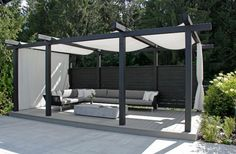 The wooden pergola is a good solution to add beauty to your garden. If you are not ready to spend thousands of dollars for building a cozy pergola then you may devise new strategies of trying out something different so that you can re Patio Pergola, Backyard Patio Designs, Deck With Pergola, Pergola Shade, Patio Roof, Pergola Designs, Pergola Kits, Backyard Landscaping, Patio Ideas
