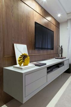 IKEA Besta Floating wall unit in high gloss white with back paneling