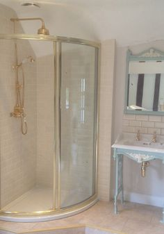 Brass shower enclosure and restored original feature sink.