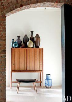 Vintage Scandinavian vessels top a midcentury cabinet in Will Ferrel's New York loft