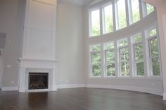 Two-story family room with curved wall of windows. Custom King's Court Builders home in South Elgin, IL