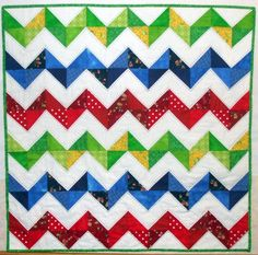 https://flic.kr/p/bxqMNn | Zigzag baby quilt | This quilt is machine pieced and hand quilted with perle cotton. Size: 36 inch square. Triangles all cut using the GO! 3 inch finished hst die.