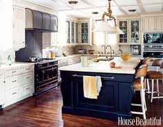 I love when black and white cabinets are combined like this