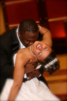 African American Bride & Groom, enjoying each other at the reception. Groom showing all his love to his bride.