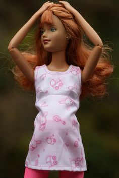 """A closer view of the lovely """"It's a girl"""" fabric.  A fun way to show off your doll."""