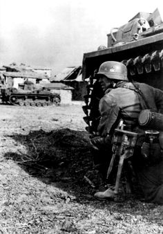 German soldiers hiding from the fire of the tank PzKpfw III during the fighting on the outskirts of Stalingrad