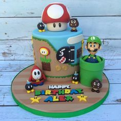 This was a Super Mario bros. themed cake for someone who liked Luigi. The top mushroom was made of Rice Krispies and fondant. Bolo Do Mario, Bolo Super Mario, Super Mario Bros, Super Mario Cupcakes, Mario Birthday Cake, Super Mario Birthday, Super Mario Party, 8th Birthday, Birthday Ideas
