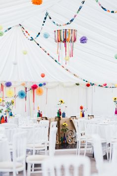 Rainbow Marquee Decor Paper Chains Ribbons Pinwheels Pom Poms All Things Big Bright Beautiful Multicolour Wedding http://benjaminmathers.co.uk/